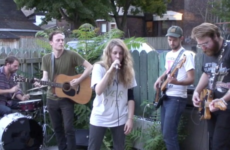 One Hundred Dollars Perform in the Back Yard