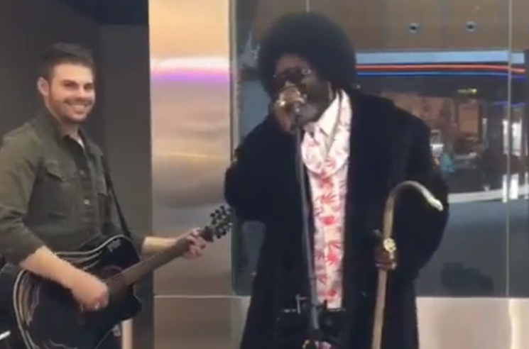 ​Watch Afroman and a Busker Cover Guns N' Roses at the Calgary Airport