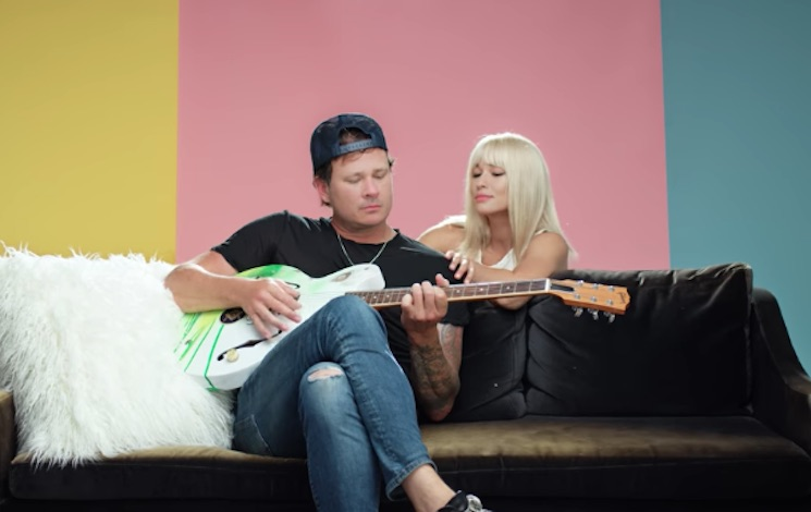 Tom DeLonge Flirts with a Model in the New Angels & Airwaves Video