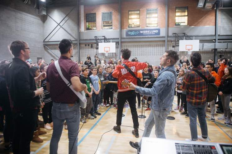 "Arkells Surprised a Calgary School to Perform ""People's Champ"" with Them"