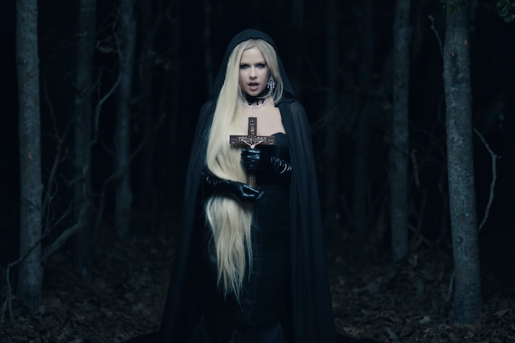 "Avril Lavigne Shares Brooding Video for ""I Fell in Love with the Devil"""