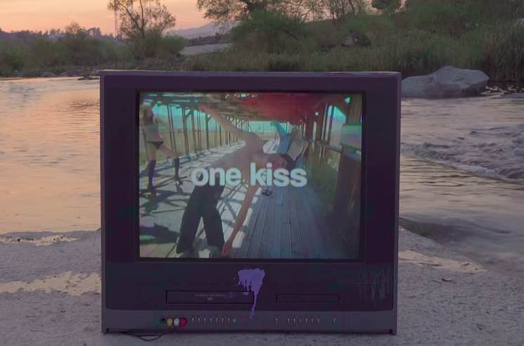 ​Calvin Harris and Dua Lipa Share 'One Kiss' Lyric Video