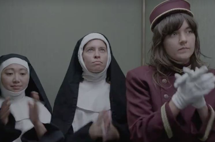"​Watch Sleater-Kinney, Jeff Tweedy Make Cameos in Courtney Barnett's ""Elevator Operator"" Video"