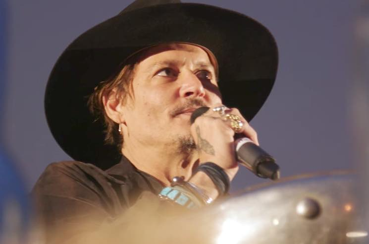 Johnny Depp Jokes About Assassinating Donald Trump at Glastonbury