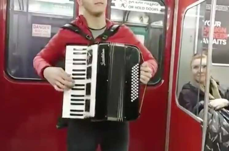 "​A Guy with an Accordion Keeps Playing ""Despacito"" on the TTC"
