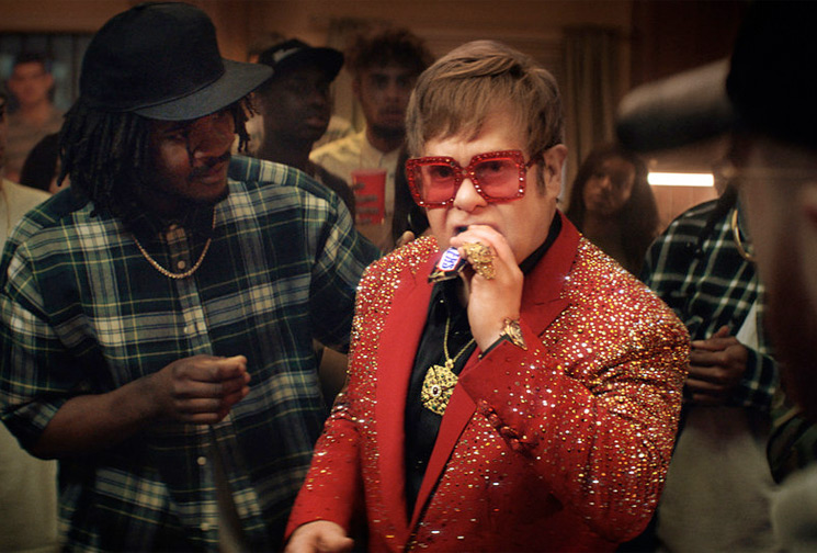 Watch Elton John Throw Down in Rap Battle