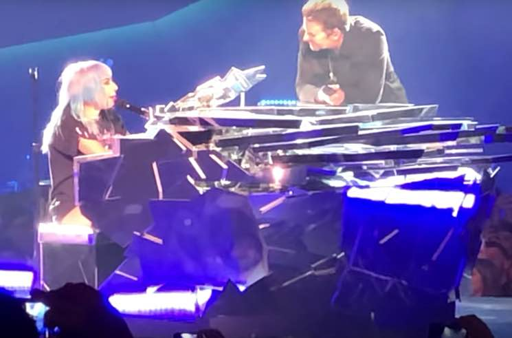 "Watch ​Lady Gaga Bring Bradley Cooper Onstage in Vegas to Perform ""Shallow"""