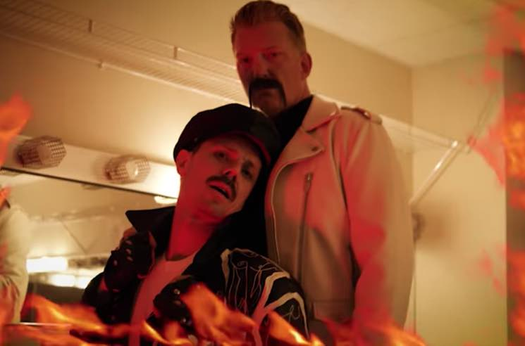 "​Josh Homme Makes a Cameo in Jake Shears' ""Big Bushy Mustache"" Video"