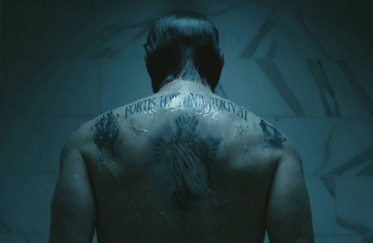 Unpacking the Surprisingly Meaningful Tattoos of 'John Wick'