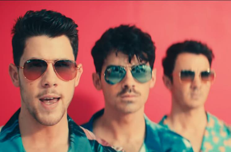 "​Jonas Brothers Go Full 'Miami Vice' for ""Cool"" Video"