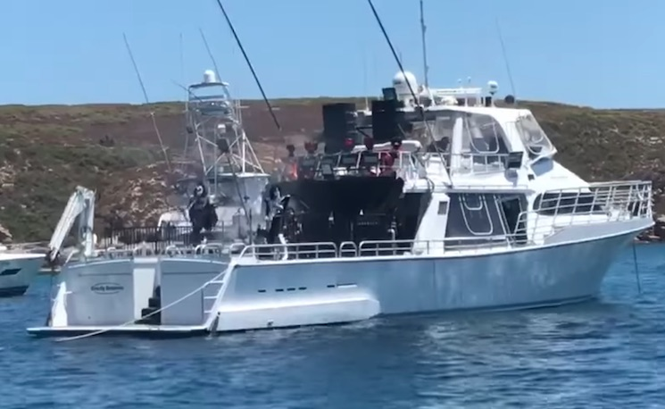Watch KISS Attempt to Play a Concert for Sharks on a Boat in Australia
