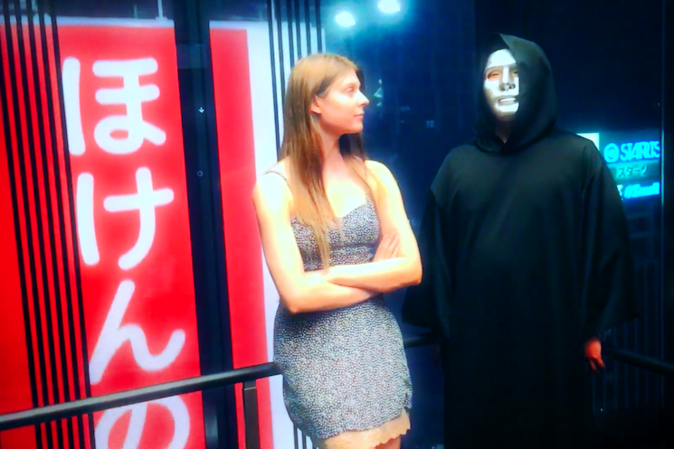 Lydia Ainsworth and a Masked Ghoul Take on Tokyo in New 'Cake' Video