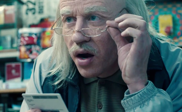 "Witness Macklemore Transform into an Elderly Store Clerk in His Epic ""Corner Store"" Video"
