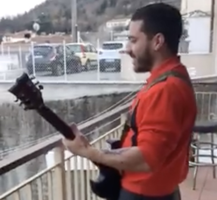 "Watch an Italian Guitarist Play Slayer's ""Raining Blood"" from His Balcony During Coronavirus Lockdown"
