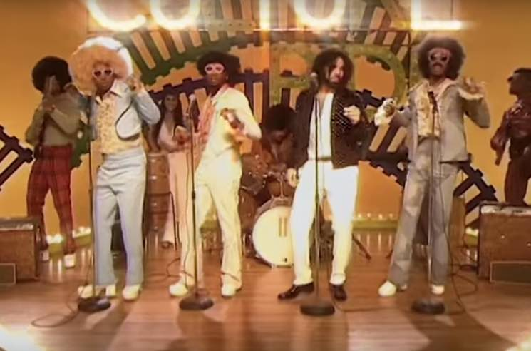 "Migos and Drake Travel Back to the '70s in ""Walk It Talk It"" Video"