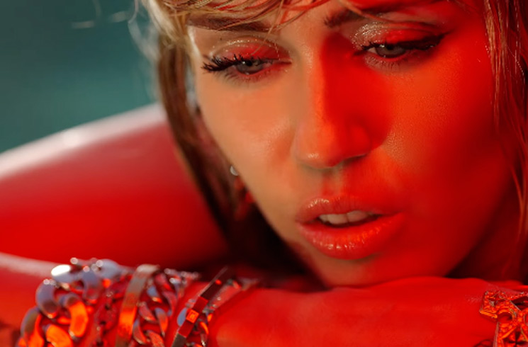 "Miley Cyrus Is Left to Pick Up the Pieces in Her ""Slide Away"" Video"
