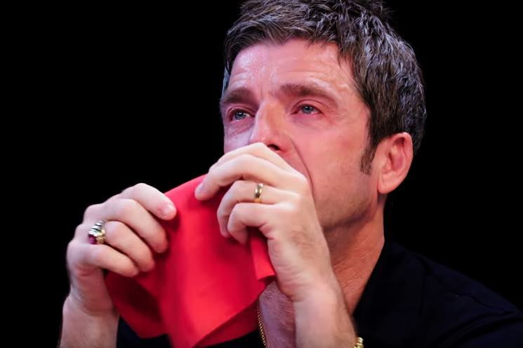 Watch Noel Gallagher Eat Spicy Chicken Wings and Cry on 'Hot Ones'
