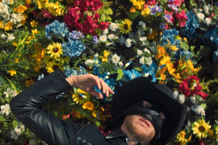 Orville Peck Becomes One with Nature in New 'Summertime' Video