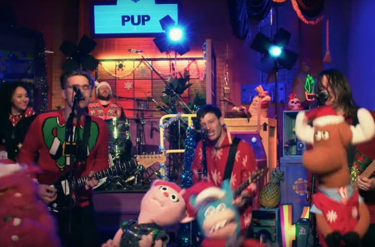"Watch PUP Turn ""Kids"" into a Family-Friendly Christmas Song with Moshing Puppets"