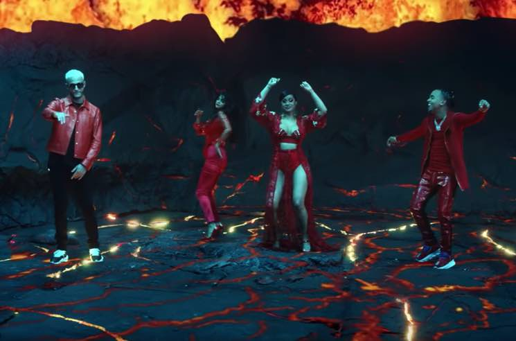 "​Selena Gomez, Cardi B, DJ Snake and Ozuna Dance on an Erupting Volcano in ""Taki Taki"" Video"