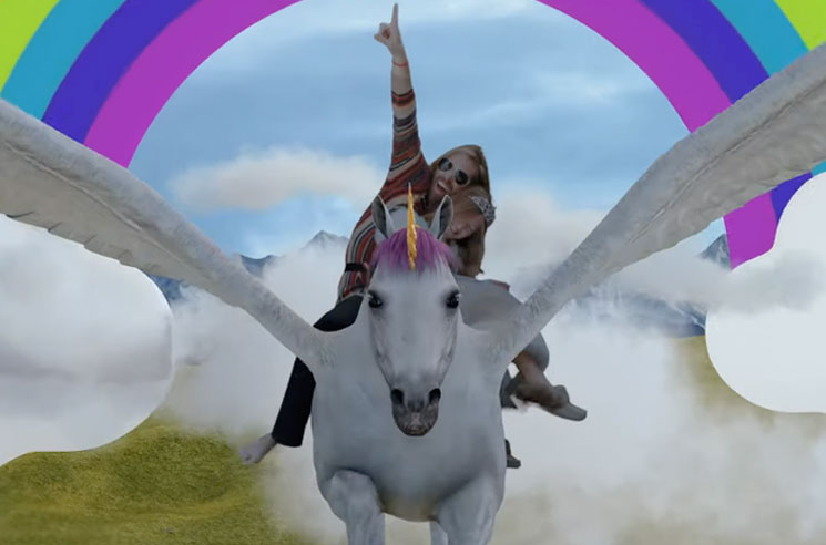 Watch Taylor Hawkins Fly Through the Sky on CGI Unicorn in His New Video