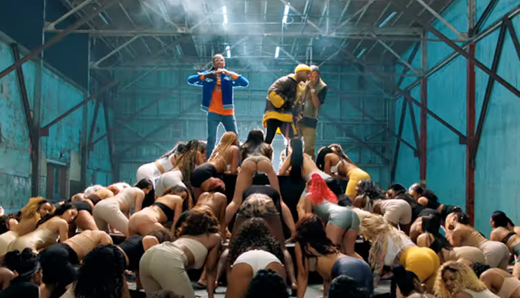 "Watch Tory Lanez, Quavo & Tyga Stand Atop Twerk Mountain in Their ""Broke Leg"" Video"
