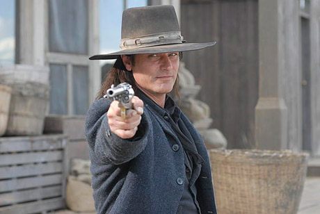 Check Out <i>Gunless</i>, <i>The Assassin Next Door</i>, <i>Heroes Season Four</i> and More in This Week's DVD Review Roundup