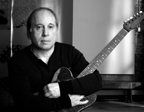 World's Worst Paul Simon Impersonator Gets Busted Running Bank Scam