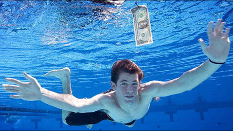 Nirvana's <i>Nevermind</i> Baby Re-enacts Famous Photo As A Teenager