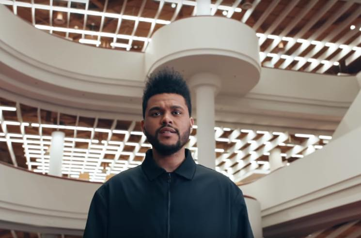 "​Watch the Weeknd Cruise Around the Toronto Reference Library in ""Secrets"" Video"