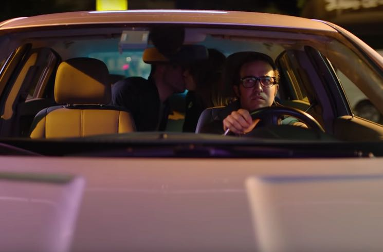 "Pete Wentz Is a 5-Star ""Hasta Luego Rideshare"" Driver in Weezer's ""Can't Knock the Hustle"" Video"