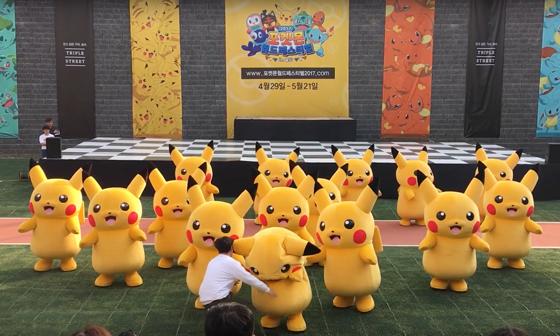 Deflating Pikachu Gets Tackled, Hustled Off Stage By Suited Men