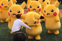 Watch a Mob of Suits Lay the Smackdown on a Dancing Pikachu