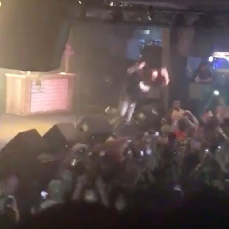 Post Malone Stage Dives Unsuccessfully During Live 'Rockstar,' Continues Performance From Floor