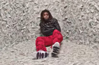 "Watch J. Cole Get Put into a Straightjacket in a Room Made of Money for His ""ATM"" Video"