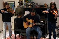"Watch Sam Roberts and His Children Perform an Adorable Version of ""We're All in This Together"""